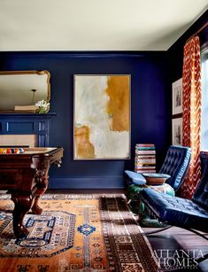 """Woodbery's vision for the home included transforming the living room into a billiards space with bold blue walls and trim for distinct character. The designer also reupholstered two Barcelona chairs that the homeowner had held onto for 30 years. """"They came from the 1970s showroom in my father's Cadillac dealership, and I knew one day I would find a place for them,"""" says Hewes."""