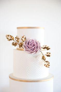 Embossed Gold and Ultra Violet Wedding Cake https://heyweddinglady.com/ultra-violet-meets-timeless-wedding-style/ #ultraviolet #pantone #wedding #weddings #weddinginspiration #weddingfashion #bridalstyle #weddingtrends #purpleweddings #weddingcakes #cakes
