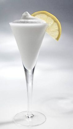 Lemon Sorbetto with lemon sorbet, vodka, and Italian Prosecco or sparkling wine. 2 cups ounces) good-quality lemon sorbet, softened 2 tablespoons vodka cup sparkling wine or Italian Prosecco wine, chilled Zest of one lemon Party Drinks, Cocktail Drinks, Cocktail Recipes, Alcoholic Drinks, Wine Recipes, Limoncello, Refreshing Drinks, Summer Drinks, White Dinner