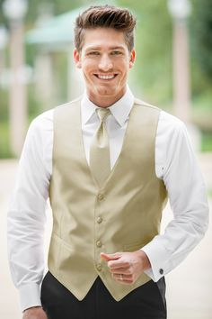 Customize your tuxedo with a vest in a range of hues to match any event or theme. Our four-button Expressions vests are fully adjustable with matching colored...