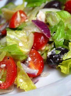 Martha Stewart's Greek Salad - Crisp greens, kalamata olives, cherry tomatoes, red onion, feta cheese & a great homemade dressing. YUM!