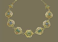 A MOROCCAN ENAMEL AND GEM-SET NECKLACE   Composed of seven flowerhead-shaped links, inset with gemstone beads, including sapphire and green beryl, to the polychrome enamel surround and reverse, with two smaller link terminals and plain back chain, closed back setting, 19th Century, 52.5 cm