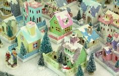 Glitter or Putz houses.  I've always wanted a little village of these tiny glittered houses.  Now I'm going to make my own.  This is a site completely devoted to the construction of these houses.