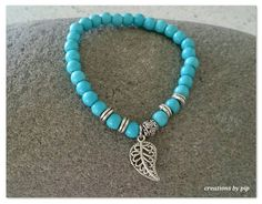 Check out this item in my Etsy shop https://www.etsy.com/uk/listing/264885594/turquoise-beaded-bracelet-with-silver
