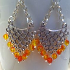 FIRE ORANGE DANGLE EARRINGS These fun and funky earrings are, a must have. I really love how the Swarovski crystals play with the light. Be the only one in your area to have a pair!!! Jewelry Earrings