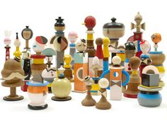 Chrissie Macdonald's imaginative creations. Geometric miniatures of ladies and gentlemen. => Could make simpler version for younger kids from small wooden craft/hardware supplies. (Ex: thimbles, chess-pieces, bobbins, spools, finials, etc.)