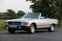 1977 Mercedes-Benz, 350SL  350 SL | 1977 S Registered | Astral Silver with Blue MB Tex Seating | Cruise Control | Headlight Wash Wipe | Standard Equipment: Early Model with 3 sp automatic transmission. Rear Seatbelt Mountings. light alloy wheels. Central locking. Electric windows. Heat insulating green glass. Graduated tinted windscreen. Front fog lamps. Power steering. Factory hard top with heated rea ..  http://www.collectioncar.com/detailed.php?ad=57691&category_id=1