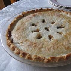 """OLD FASHIONED RAISIN PIE – """"This is EXCELLENT raisin pie.""""          2 cups raisins,  2 cups water,  1/2 cup packed brown sugar,  2 tablespoons cornstarch,  1/2 teaspoon ground cinnamon,1/4 teaspoon salt,  1 tablespoon distilled white vinegar,  1 tablespoon butter,  1 recipe pastry for a 9 inch double crust pie."""