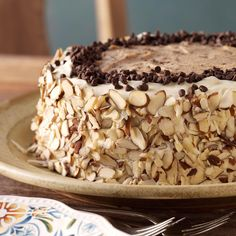 Marvelous Cannoli Cake Recipe -A luscious, chocolate-studded cannoli filling separates the tender vanilla layers of this rich cake, which starts with a package mix. It's best when served well chilled.—Antoinette Owens, Ridgefield, Connecticut