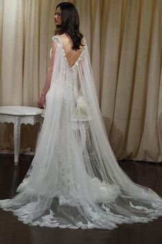 Badgley Mischka lace wedding dress with cape-train