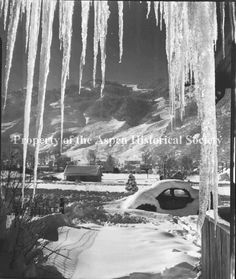 Another great old shot from Aspen Historical Museum of a car in a few feet of snow.