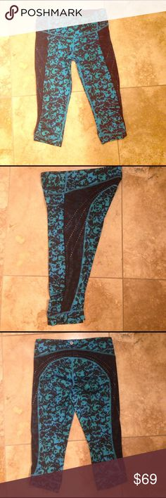 NWOT Lululemon blue floral mesh sides crop size 4 NWOT Lululemon blue floral mesh sides crop size 4. Stop at nothing black kayak blue crop. Mesh sides with reflective dots underneath. Front zip pocket. Inside pocket. I love these and wore them once but they're too small on me. Sad for me happy for you.  Not Nike, adidas, oiselle, Lorna Jane, Lucy, Brooks, new balance. lululemon athletica Pants Ankle & Cropped