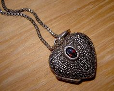 early 1990s sterling silver marcasite and garnet heart locket - charity for animals via Etsy