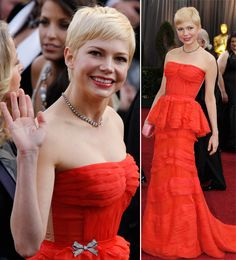 At the 2012 Oscars; Michelle Williams in a red Louis Vuitton dress,  loved her makeup, hair and dress.