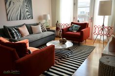 nicole lanteri living room ikea stockholm rug red chairs red pink gray room pink paint