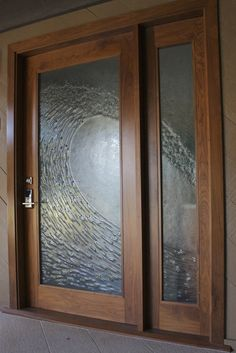 Custom cast glass door with a crashing wave pattern