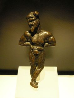 Chained Germanic, 2nd century A.D. Bronze. The prisoner wears breeches that were typical for Germanics. His hair is tied in a suebian knot.