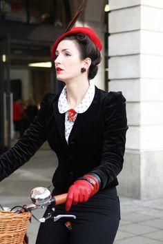 Fleur De Guerre of the Vintage Mafia in velvet jacket and red wool hat. A bike is always stylish.
