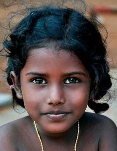 Hair: black Eyes: brown Skin: dark Age: child looks just like my