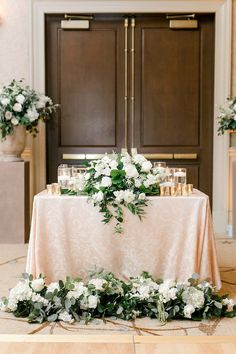 Beautiful white floral centerpiece for a wedding reception - perfect for a sweetheart table, cocktail hour, or any table decor at the reception! #weddingflowers #receptionideas #virginiaweddingflorist