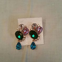 """Gold tone dangle rinestone earrings 1"""" Post earring covered with pink, emerald green, and clear rinestones. Dangling 1/2"""" blue rinestone teardrop. Earring is 1 3/4"""" long, 3/4"""" width. Blingy!! Jewelry Earrings"""