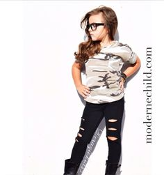 Kayla @doraziokids3 for ModerneChild ~ our rocker dolly! Love her in our Camouflage Tee & Ripped Black Leggings! To shop this edgy look, visit www.modernechild.com . #kidsfashion #trendy #kids #clothes #trendykidsclothes #fashion #edgy #kidslookbook