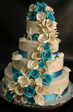 Beautiful blue and white cake with shells. (You could keep the shells and starfish for Fount and go with aqua and amethyst instead of turquoise and white flowers. Tee )