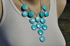 Bubble necklace/ Statement necklace/ Bib necklace/ Bright blue flat round beads. $25.00, via Etsy.