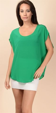 This oversized silk top features a scoop neckline with dropped armhole and dolman sleeves. Seamed back yoke with gathers at center back. Self binding at neck and armhole with curved shirttail hem.100% silkDry clean only