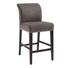 A luxurious counter stool with a sumptuous rolled back and silver nail head. Stocked in our soft and resilient Portsmouth fabric in grey with matte black legs.