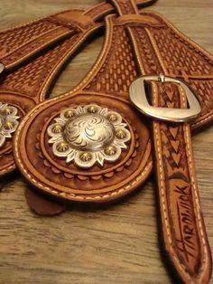 Custom spur straps by Bryce Hardwick of HARDWICK LEATHER Got the same concho on my hatband:)