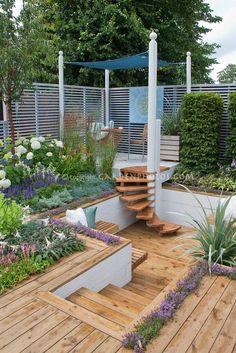multilevel deck, garden. outdoor spiral steps.