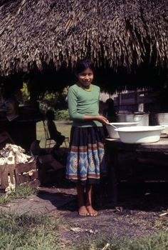 Seminole girl at the Clay family village in the Everglades.