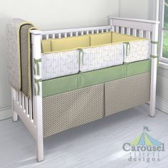 Crib bedding in Stone Windowpane, Taupe Baby Giraffe, Solid Banana, Heather Sage Green. Created using the Nursery Designer® by Carousel Designs where you mix and match from hundreds of fabrics to create your own unique baby bedding. #carouseldesigns