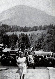 der-wolf: Adolf Hitler arrives at The Berghof in 1940. Eva Braun in foreground.