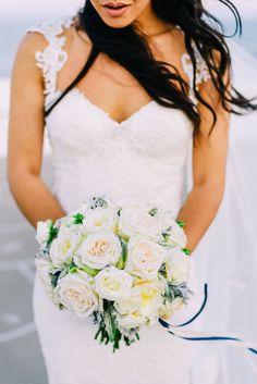 white bouquet - photo by Elias Kordelakos http://ruffledblog.com/destination-wedding-weekend-in-sifnos-greece