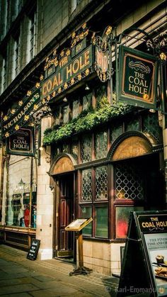 The Coal Hole pub - Pub in former coal cellar for the Savoy Hotel, with antique tiled floors and real ale selection. 91-92 Strand, London