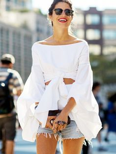 White off the shoulder dramatic top with knots and cut outs + denim cut off shorts