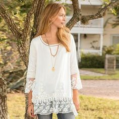 BETROTHED EMBROIDERED TUNIC - Devote yourself to our beautiful, tonal embroidered tunic, with tonal embroidery, inset ladder lace at neckline. Ruffled, mesh and lace hi-lo hem and three-quarter sleeves.
