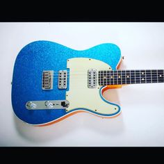 """Happy #TeleTuesday! 2014 Fender #Telecaster Proudly and creatively made by the custom shop in blue sparkle. The neck is quartersawn maple. The body is something called lightweight """"Okune"""" which looks, when tinted, a bit like Korina. Dark Rosewood fingerboard. Two classic pick ups made by our beloved @tvjonesinc -- whom this community celebrates. The only thing I would change are the saddles on that hard tail. I would go with Callaham. @callahamguitars steel saddles. This one might have the…"""