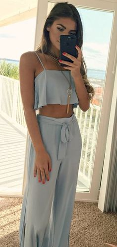 #winter #outfits women's blue spaghetti-strap crop top and blue pants outfit