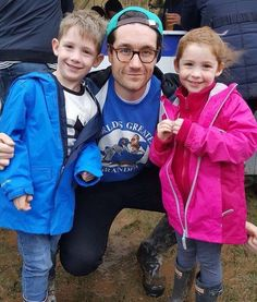 Dan Smith, in a World's Greatest Grandpa sweatshirt, with two kids