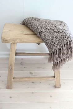 stool and knit throw