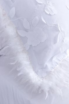 White chiffon leaves and flowers are trimmed with soft white feathers on this unique pillow sham.  C L O U D H U N T E R  http://cloudhunterco.com/all-products/cinderella-pillow-sham