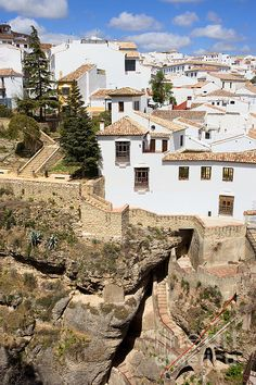 Medieval houses of Ronda town on a high rock in Andalusia region of Spain, Malaga province. Places Around The World, Travel Around The World, Around The Worlds, Places To Travel, Places To Go, Malaga Spain, Andalusia Spain, Adventures Abroad, Spain And Portugal