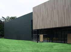 Olympic Training Centre - Arnhem - Netherlands | Profile: Bevel & Eurochannel.  Colours: RAL 6009 and 3 shades of Cape Cod Sandalwood
