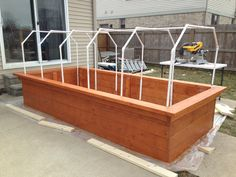 Raised garden bed. My Hubby and sons built this awesome box with a frame for a cover, so I could get a jump start on my garden.