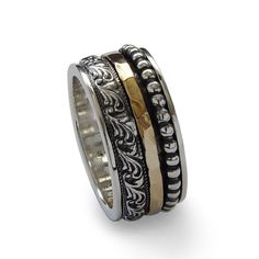R1149H  Wide band with gold spinner and dotted silver spinner. Its a classic design that compliments any look and style!  An amazing wedding band for both men and woman or simply everyday ring. The spinners move freely on the main band, held on by the wider band's edges. Given that the gemstones are natural and our jewelry is handmade especially for you, please consider that color variations and slight variances are normal. Therefore, items are not identical to the photographs but equally…