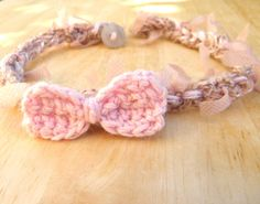 Little bow crocheted baby halo headband textured pale powder pink bow photography photo prop newborn girl crochet pastel soft. $10.90, via Etsy.