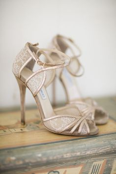 Jimmy Choo bridal shoes: stunning off white high heel sandals with peep toes and ankle straps.